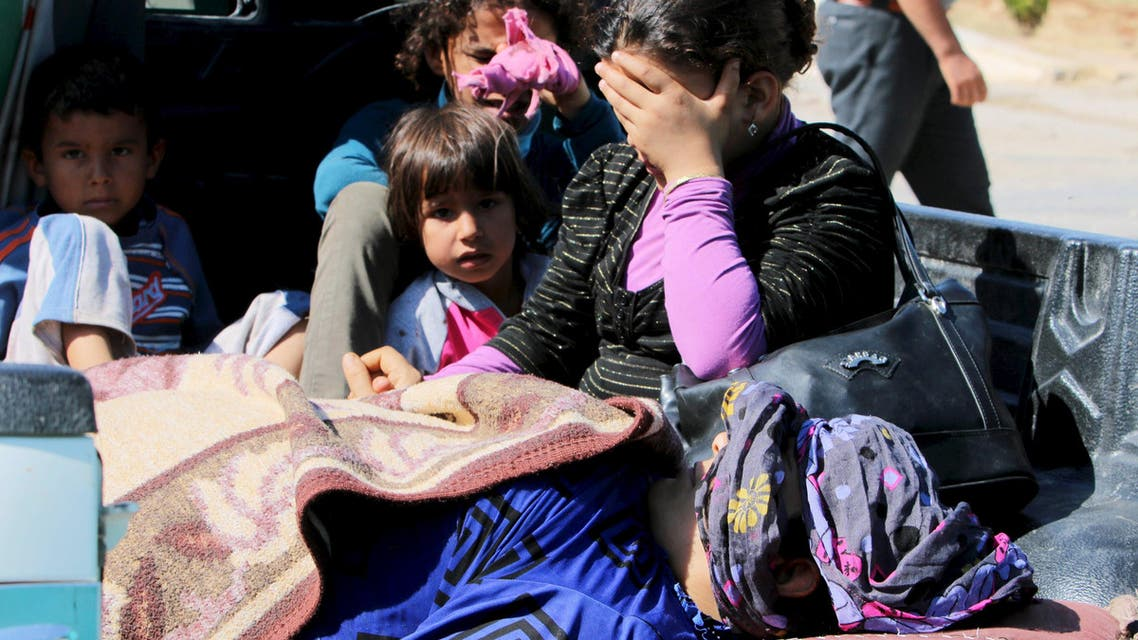 Civilians, who were wounded by what activists said was violence caused by ISIS fighters in Kobane, wait with their relatives to cross into Turkey at the Syrian-Turkish border crossing of Tel Abyad, Syria June 25, 2015. (Reuters)