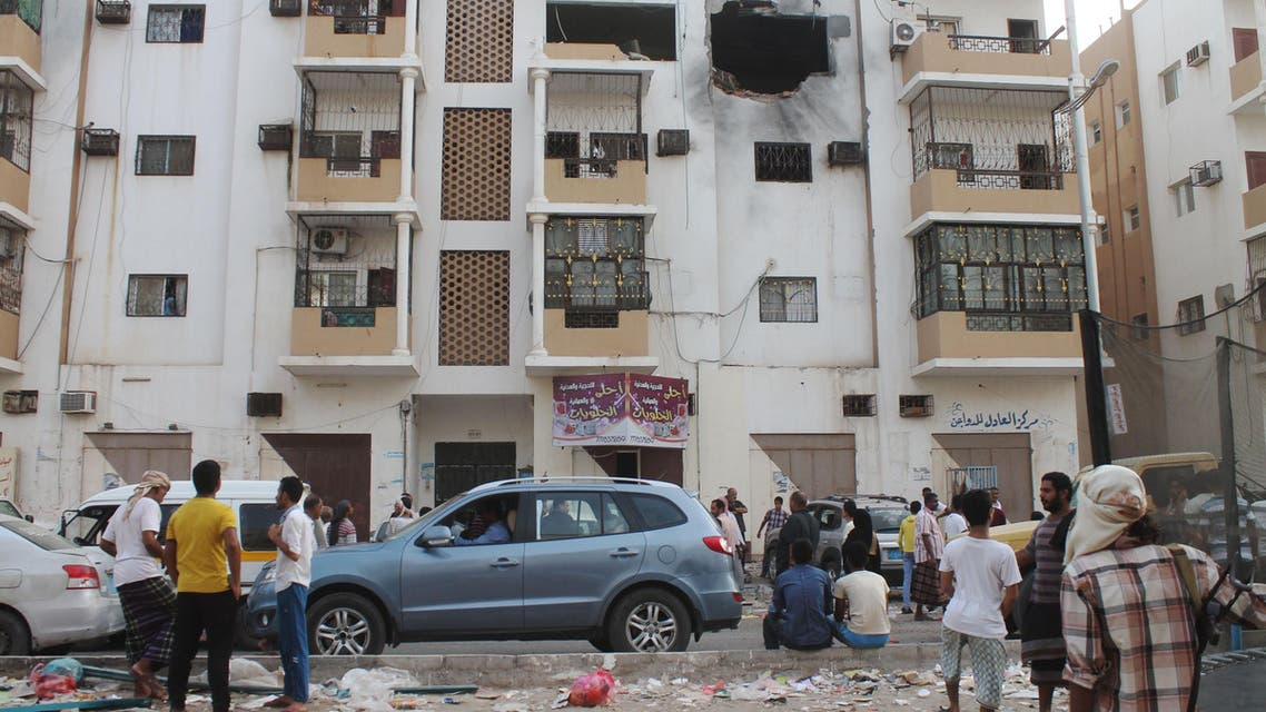 Yemenis inspect a destroyed building in Aden's suburbs on June 24, 2015 after rebel forces and loyalist fighters were locked in fierce fighting. (AFP)