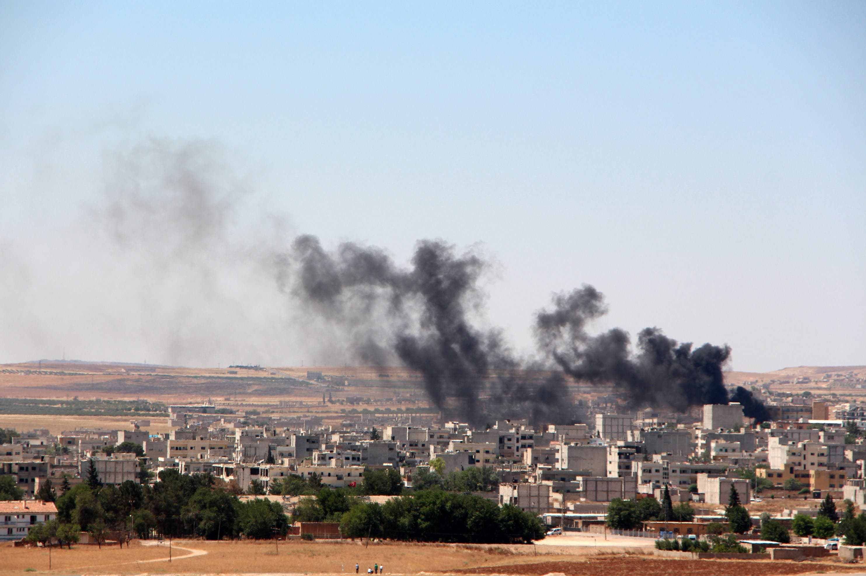 moke billow from the Syrian town of Kobane, as seen from the Turkish side of the border in Suruc in Sanliurfa province on June 25, 2015. (AFP)