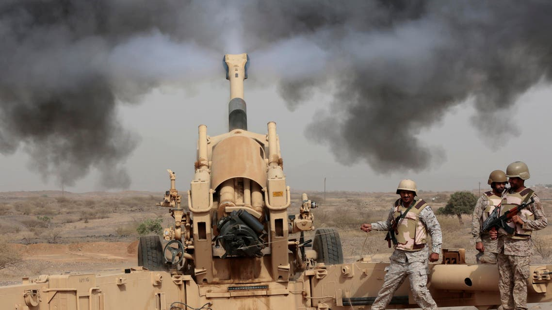 Saudi soldiers fire artillery toward three armed vehicles approaching the Saudi border with Yemen in Jazan, Saudi Arabia, Monday, April 20, 2015. AP