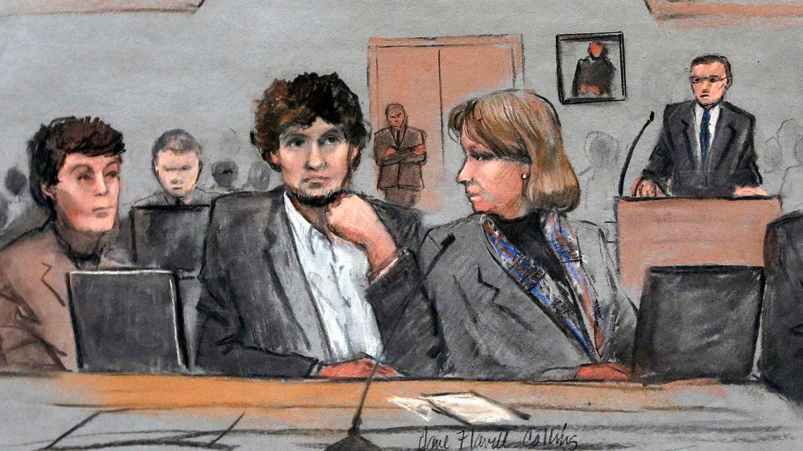 In this courtroom sketch, Dzhokhar Tsarnaev, center, is depicted between defense attorneys Miriam Conrad, left, and Judy Clarke, right, during his federal death penalty trial, Thursday, March 5, 2015, in Boston. Tsarnaev is charged with conspiring with his brother to place two bombs near the Boston Marathon finish line in April 2013, killing three and injuring 260 people. (Jane Flavell Collins via AP)