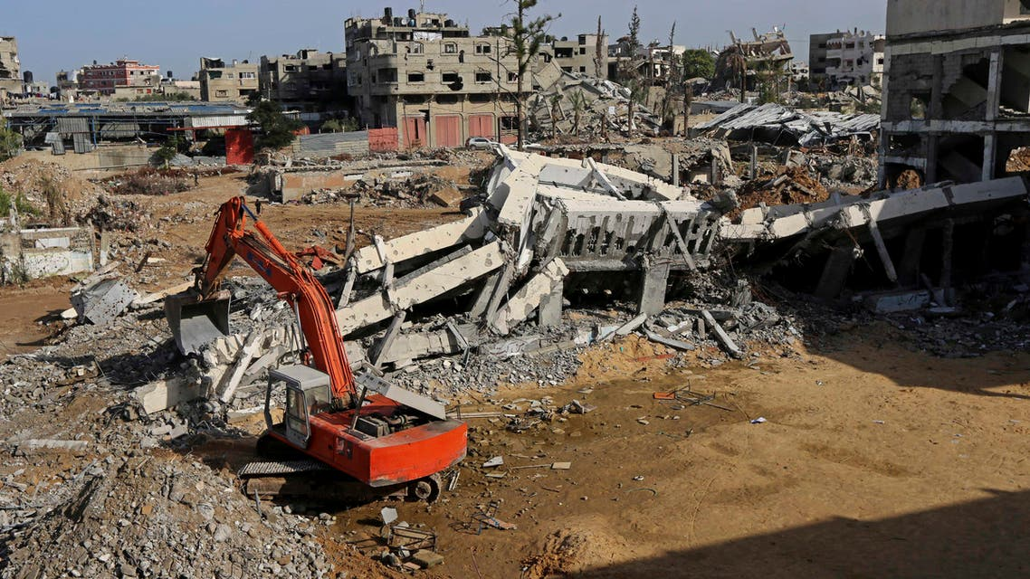 A Palestnian crane removes the rubble of Jamal Abdelnaser UNRWA School which was destroyed during the recent conflict between Israel and Hamas in Shijaiyah, neighborhood in Gaza City, in the northern Gaza Strip, Wednesday, Dec. 3, 2014. The first large-scale project to remove rubble from the most recent war in the Gaza Strip started Wednesday, a step perceived as notable on the long path of rebuilding. The project is taking place in Shijaiyah, east Gaza City, one of three areas where Israeli artillery shells destroyed or damaged tens of thousands of houses. Sweden is paying $3.2 million for this project through UNDP's Programme of Assistance to the Palestinian People, where officials hope to crush and clear 140,000 tons of rubble in Shijaiyah in one year. (AP Photo/Adel Hana)