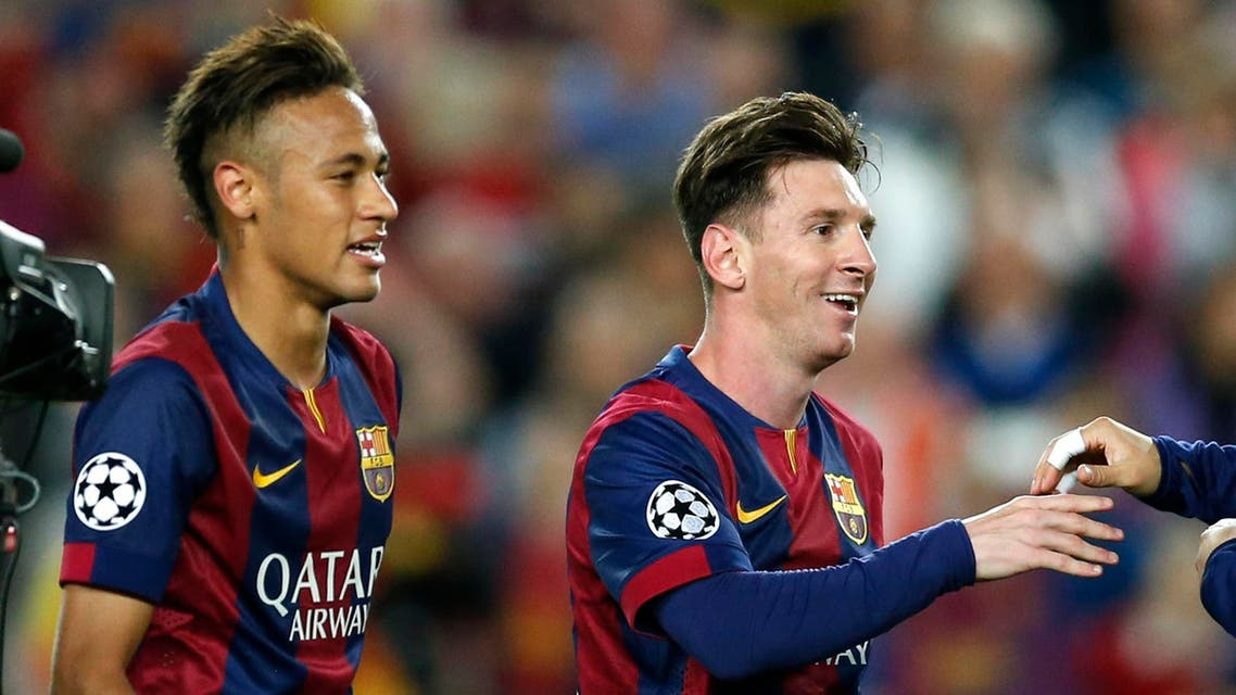 Barcelona's Neymar, left, and Lionel Messi celebrate after winning 3-0 in the Champions League semifinal first leg soccer match between Barcelona and Bayern Munich at the Camp Nou stadium in Barcelona, Spain, Wednesday, May 6, 2015. (AP)