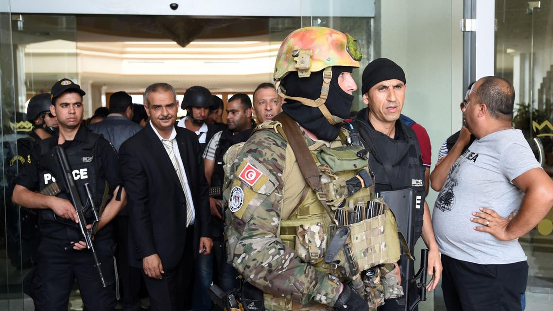 Tunisian security forces stand in front of the Imperial hotel in the resort town of Sousse, a popular tourist destination 140 kilometres (90 miles) south of the Tunisian capital, on June 26, 2015. (AFP)
