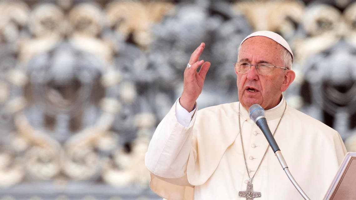 Pope Francis delivers his blessing at the end of his weekly general audience, in St. Peter's Square, at the Vatican, Wednesday, June 24, 2015. (AP Photo/Riccardo De Luca)