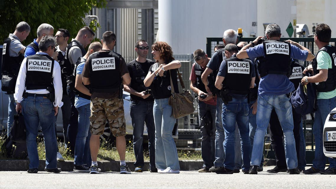 E : French police secure the entrance of the Air Products company in Saint-Quentin-Fallavier, near Lyon, central eastern France, on June 26, 2015. (AFP)