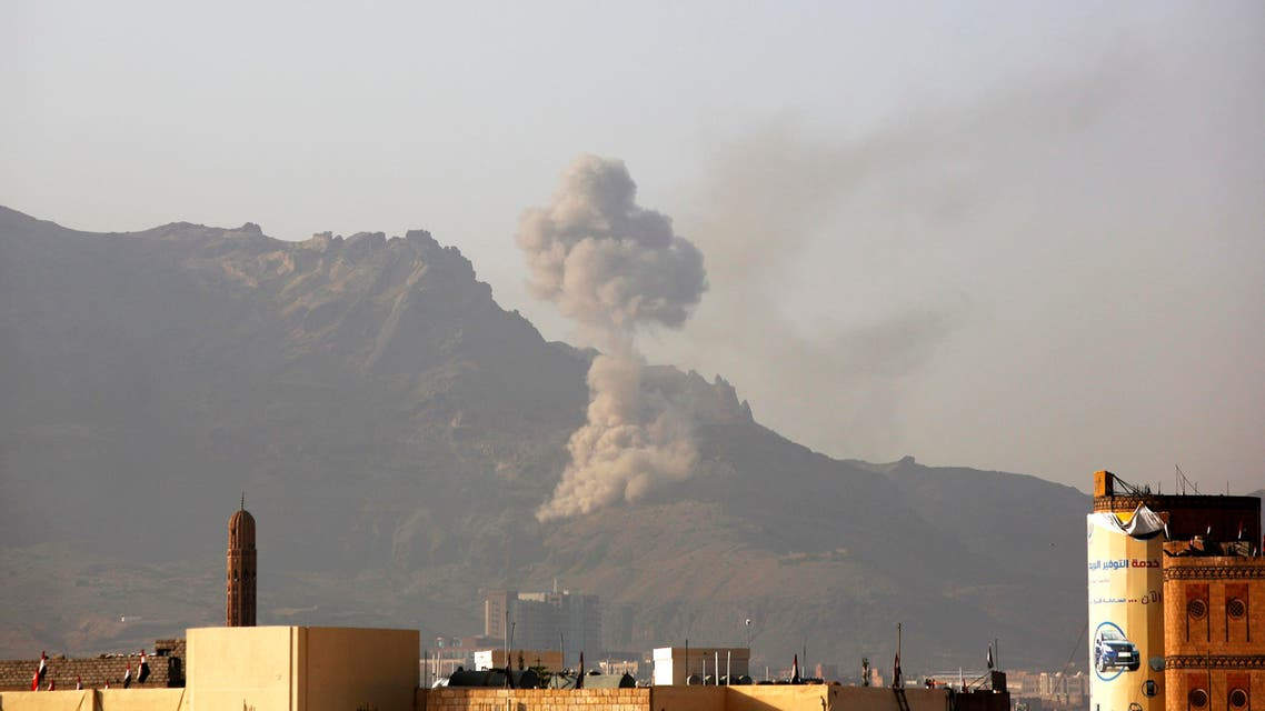 Smoke rises after a Saudi-led airstrike hit a site believed to be one of the largest weapons depot on the outskirts of Yemen's capital, Sanaa, on Wednesday, June 17, 2015. AP