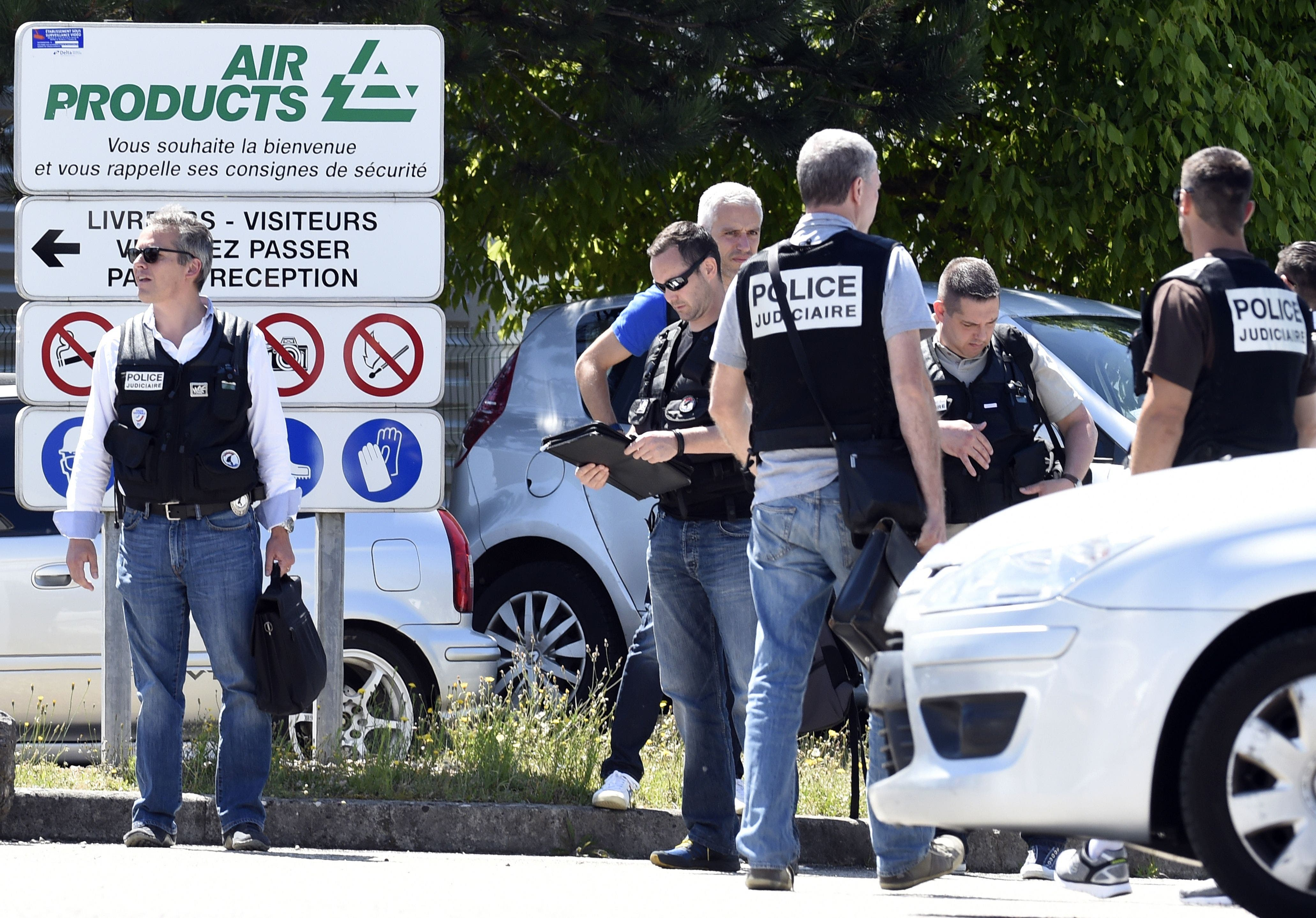French police secure the entrance of the Air Products company in Saint-Quentin-Fallavier, near Lyon, central eastern France, on June 26, 2015. (AFP)