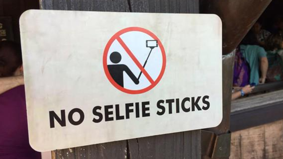 Starting next week, security personnel will ask Disney guests who arrive with selfie sticks at the parks to stow them at a storage facility. (Courtesy of Twitter)