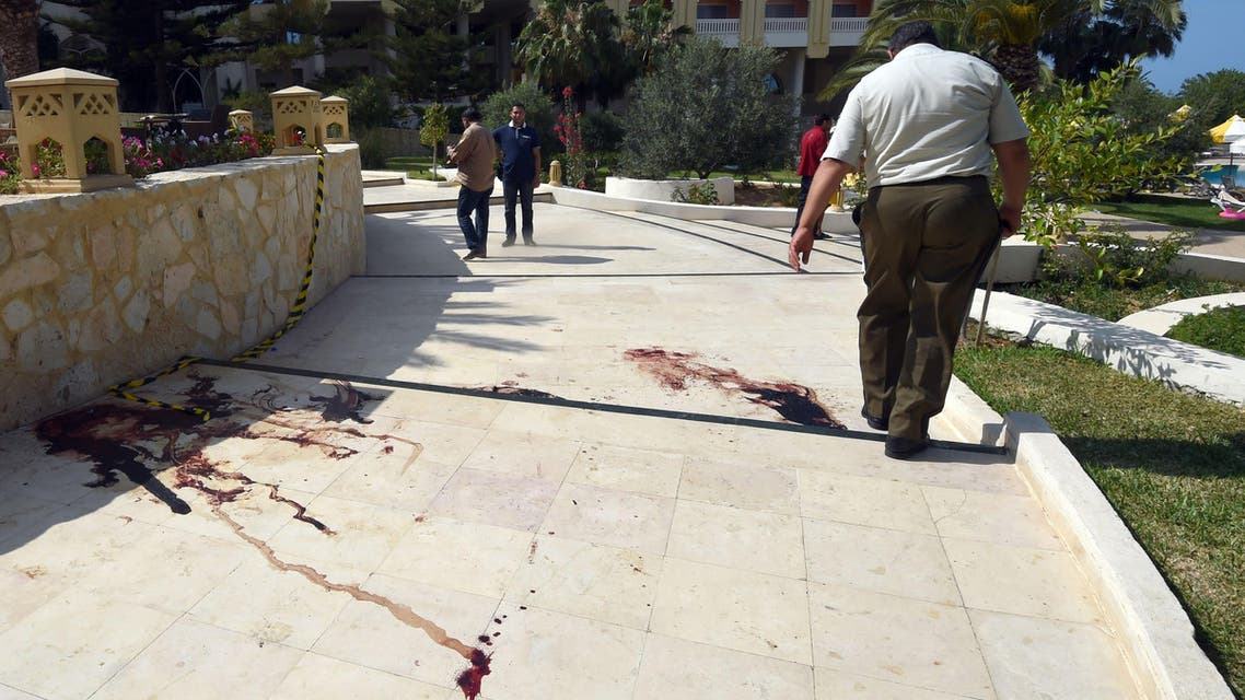 A Tunisian man walks past a blood stain on the ground at the resort town of Sousse, a popular tourist destination 140 kilometers (90 miles) south of the Tunisian capital, on June 26, 2015, following a shooting attack. (AFP)