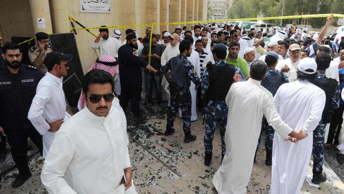 Security forces, officials and civilians gather after a deadly blast claimed by ISIS that struck worshippers attending Friday prayers at a Shiite mosque in Kuwait City, Friday, June 26, 2015. (AP)