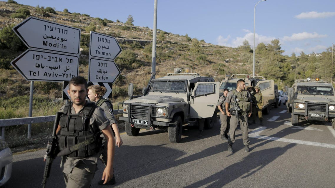 Israeli troops at a checkpoint in the occupied West Bank on Friday after shooting