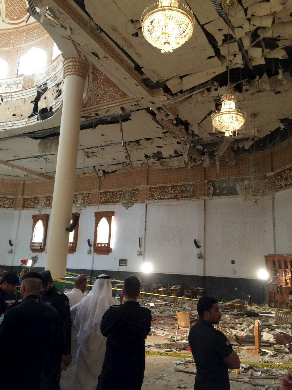 Police inspect the Imam Sadiq Mosque after a bomb explosion, in the Al Sawaber area of Kuwait City June 26, 2015. (Reuters)
