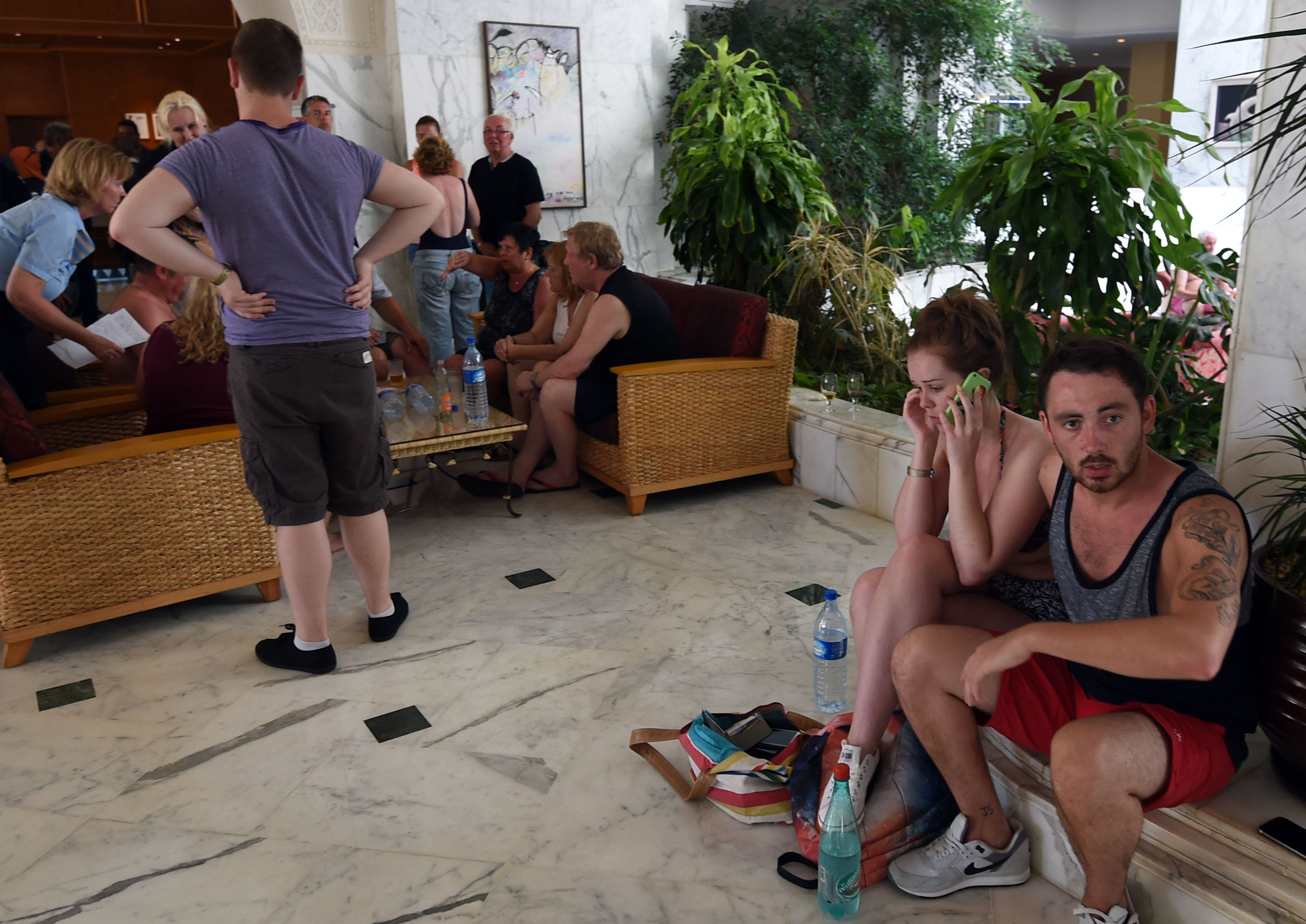 Tourists react at the Imperial hotel in the resort town of Sousse following a shooting attack. (AFP)