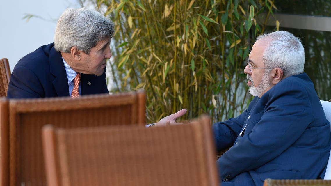 U.S. Secretary of State John Kerry, left, talks with Iranian Foreign Minister Mohammad Javad Zarif, in Geneva, Switzerland, Saturday, May 30, 2015. AP