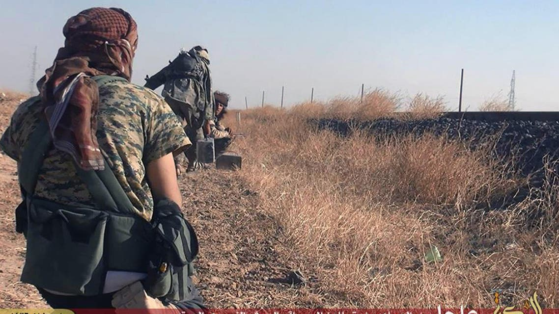 In this photo provided by a website of the ISIS militants, taken Thursday, June 25, 2015, ISIS militants move toward Syrian government forces' positions in the predominantly Kurdish Syrian city of Hassakeh, Syria. (AP)