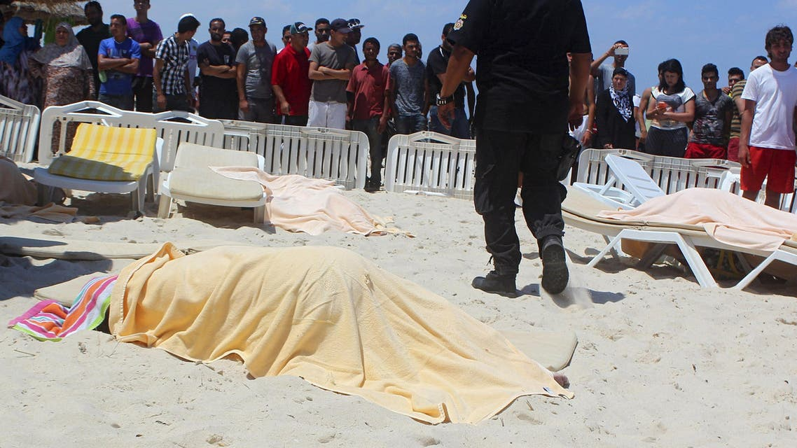 The body of a tourist shot dead by a gunman lies near a beachside hotel in Sousse, Tunisia June 26, 2015. (Reuters)