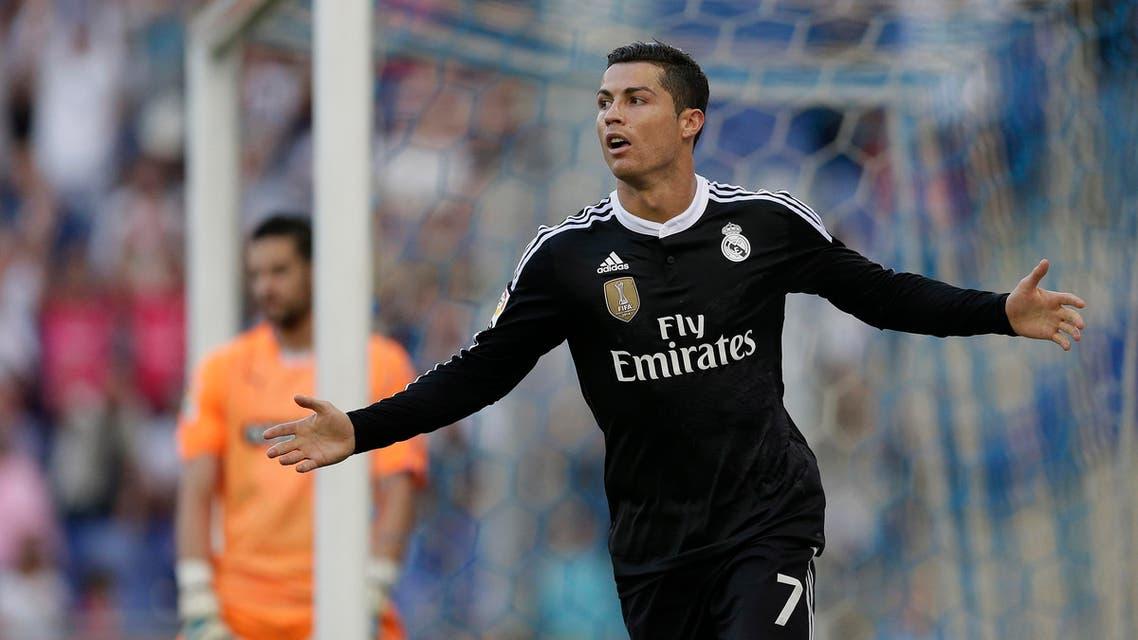 Real Madrid's Cristiano Ronaldo, from Portugal, reacts after scoring against Espanyol during a Spanish La Liga soccer match at Cornella-El Prat stadium in Cornella Llobregat, Spain, Sunday, May 17, 2015. (AP)