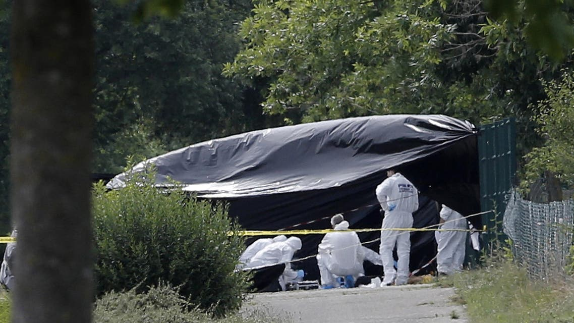 Police officers investigate at a plant where an attack took place, Friday, June 26, 2015 in Saint-Quentin-Fallavier, southeast of Lyon, France. AP