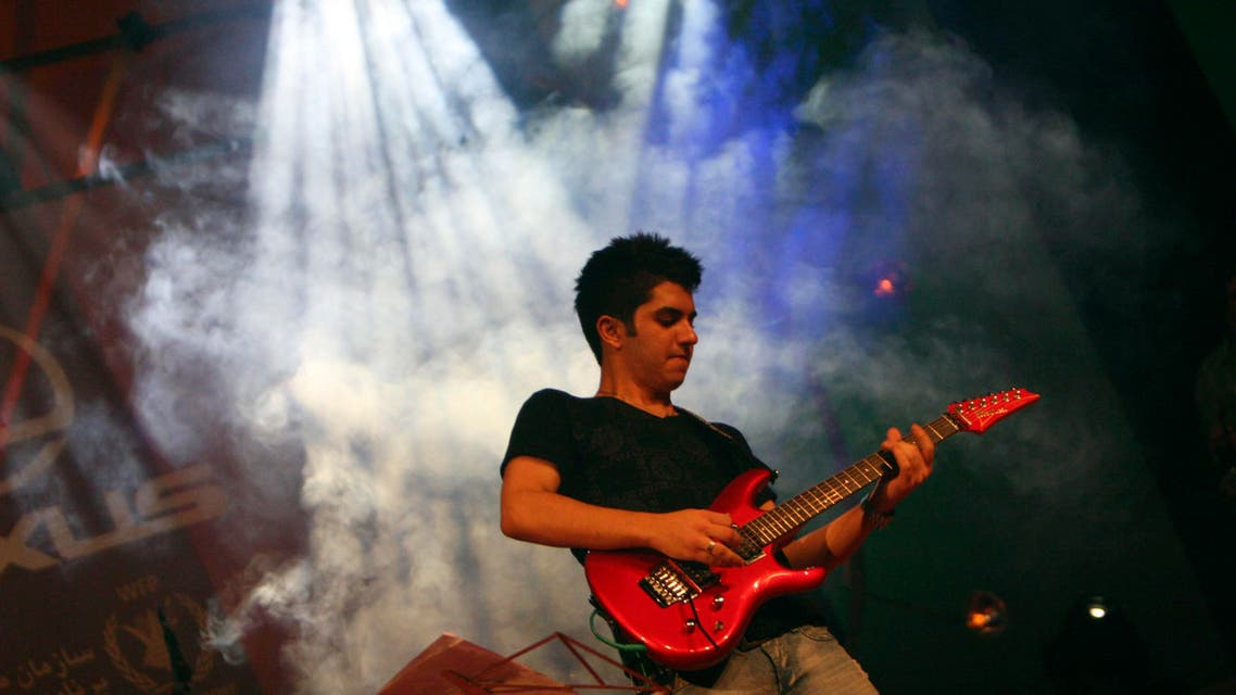 An Iranian player performs during a pop concert in Kish Island, Iran, Sunday Aug. 3, 2008. AP