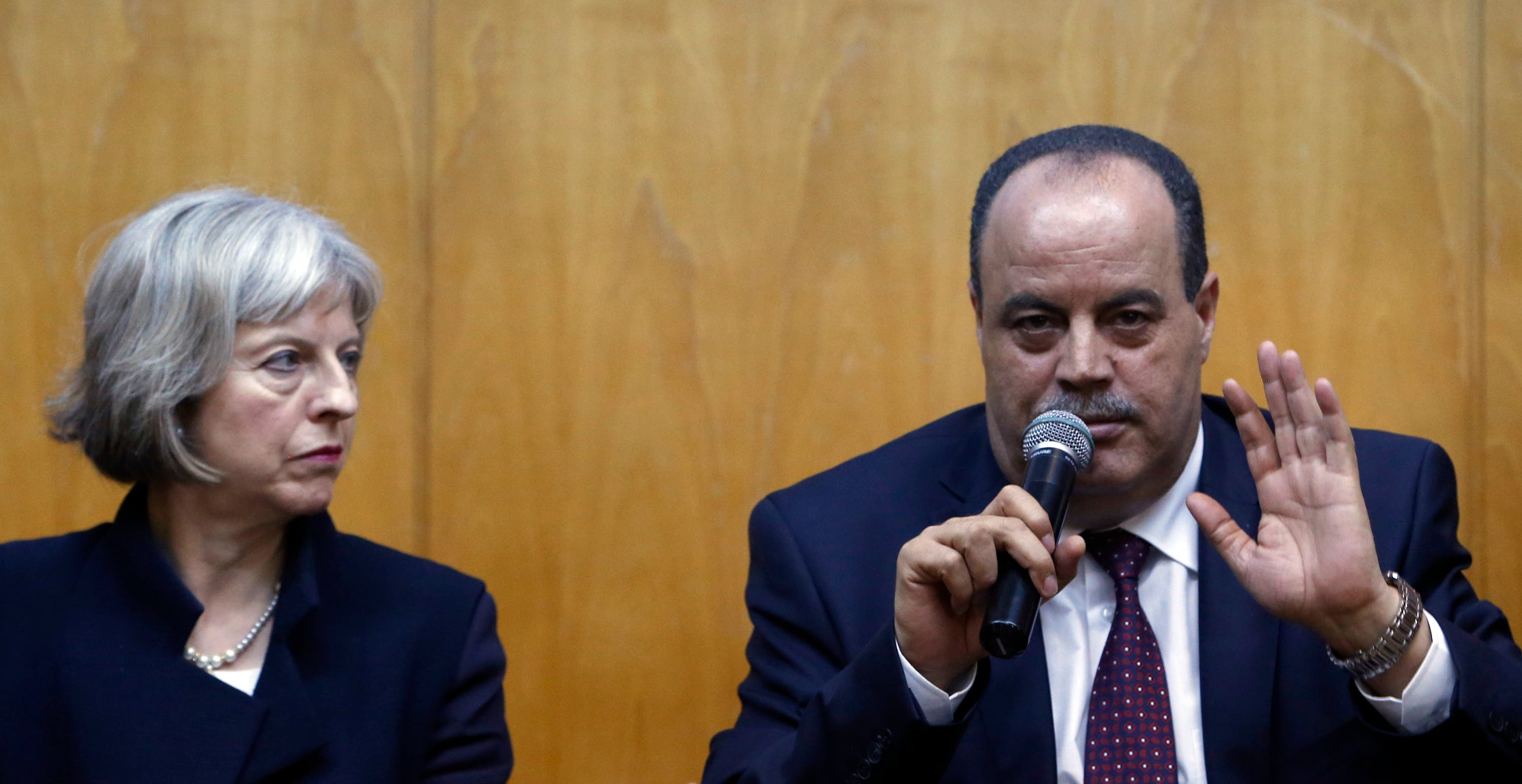 Tunisian Interior Minister Mohamed Najem Gharsalli, right, speaks with British Home Secretary Theresa May, during a press conference in Imperial Marhaba hotel in Sousse, Tunisia, Monday, June 29, 2015, the scene of Friday's beach massacre. (AP)