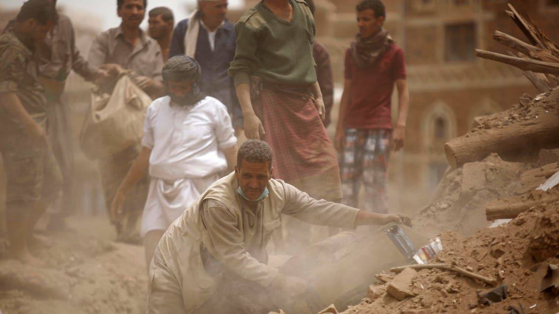 People search for survivors under the rubble of houses destroyed by Saudi airstrikes in the old city of Sanaa, Yemen, Friday, June 12, 2015. (Reuters)