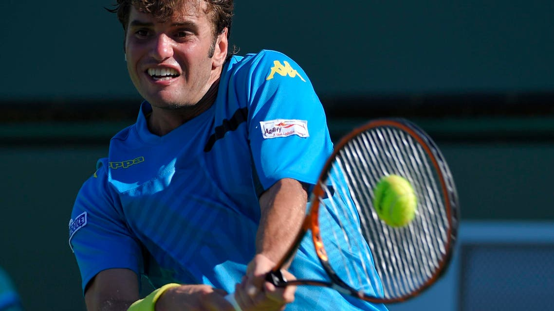 Malek Jaziri, of Tunisia, returns to Tatsuma Ito of Japan during their match at the BNP Paribas Open tennis tournament, Friday, March 13, 2015, in Indian Wells, Calif. (AP Photo/Mark J. Terrill)