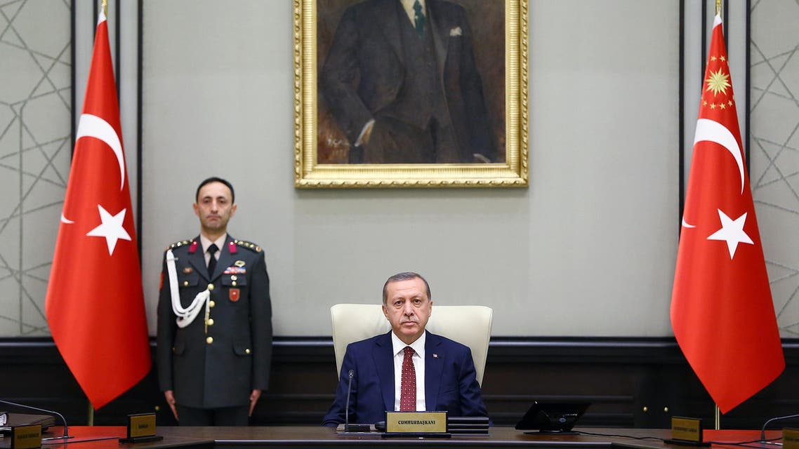 A handout picture taken and released on June 29, 2015 by the Turkish Presidential Palace Press Office shows Turkey's President Tayyip Erdogan heading the National Security Council meeting in Ankara. Turkish President Recep Tayyip Erdogan chaired a top security meeting today as media speculated that Ankara was planning a military intervention in Syria, following gains there by Kurds against the jihadists. AFP PHOTO / TURKISH PRESIDENTIAL PALACE PRESS OFFICE / KAYHAN OZER