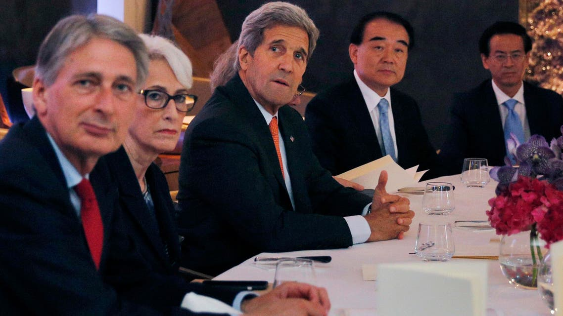 British Foreign Secretary Philip Hammond, left, U.S. Under Secretary for Political Affairs Wendy Sherman, 2nd left, U.S. Secretary of State John Kerry. centre, and China's deputy foreign minister Li Baodong, 2nd right. AP