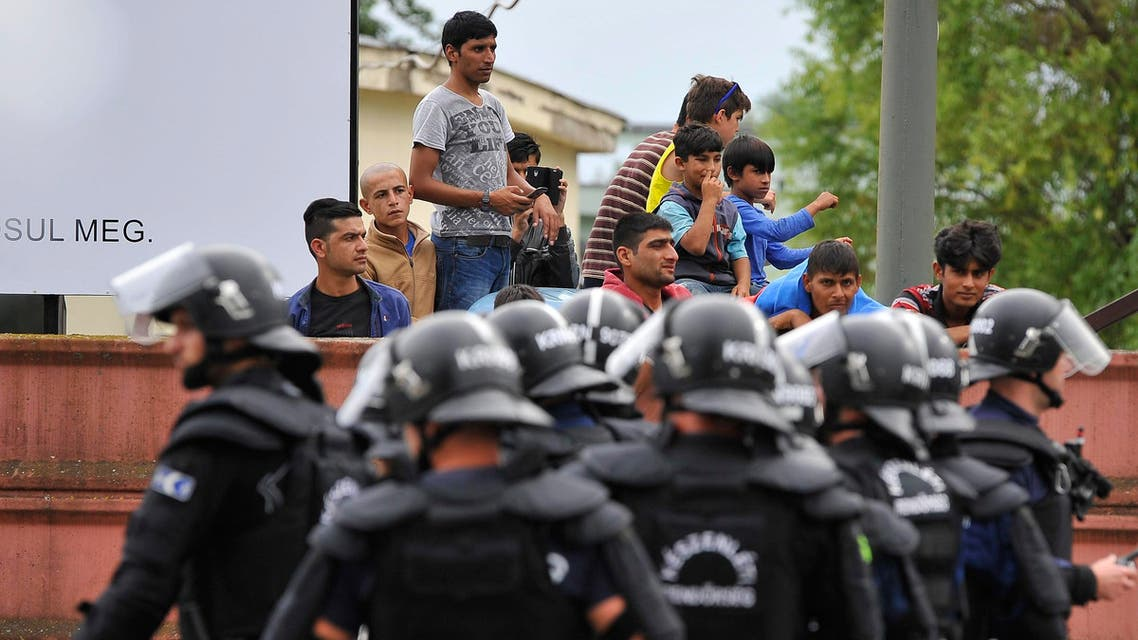 Policemen stand at the entrance of the Debrecen refugee camp in Debrecen, 230 kms from Budapest, Hungary, Monday, June 29, 2015. AP