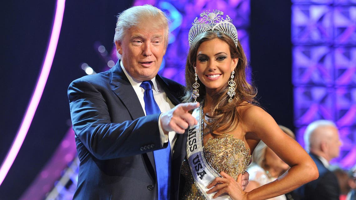 Donald Trump, left, and Miss Connecticut USA Erin Brady pose onstage after Brady won the 2013 Miss USA pageant in Las Vegas, Nev. Univision says it is dropping the Miss USA Pageant and says it will cut all business ties with Donald Trump over comments he made about Mexican immigrants. AP