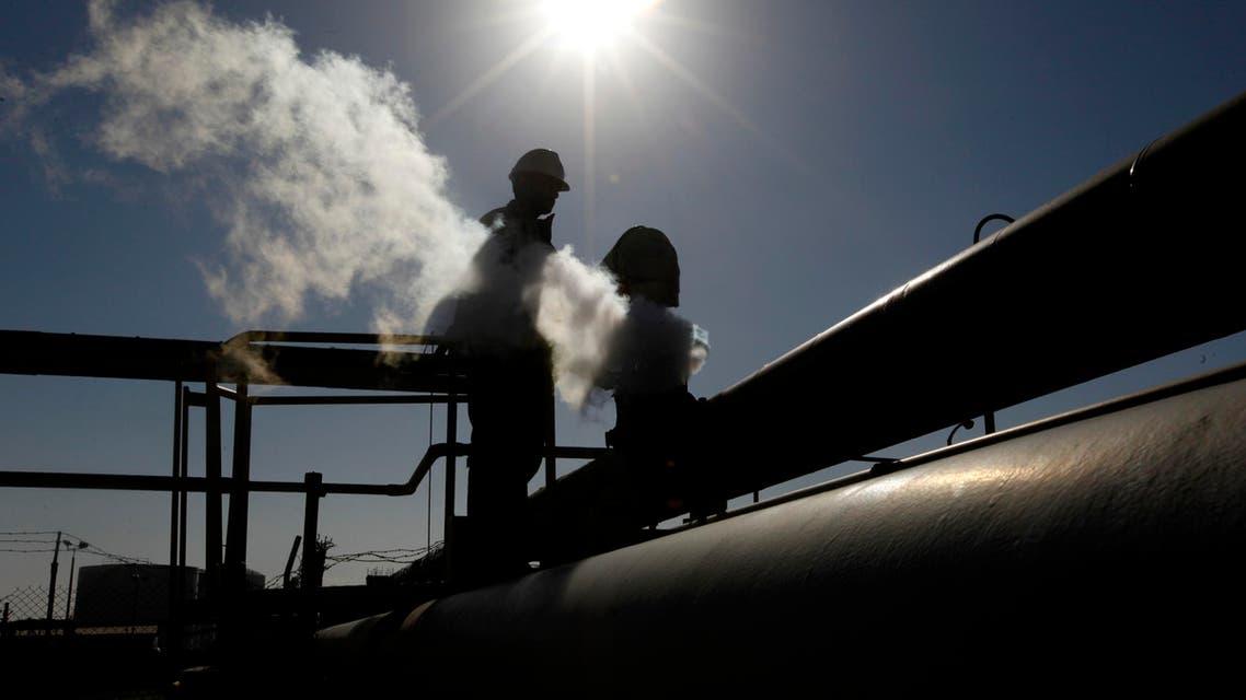 A Libyan oil worker, works at a refinery inside the Brega oil complex, in Brega, eastern Libya. (File Photo: AP)