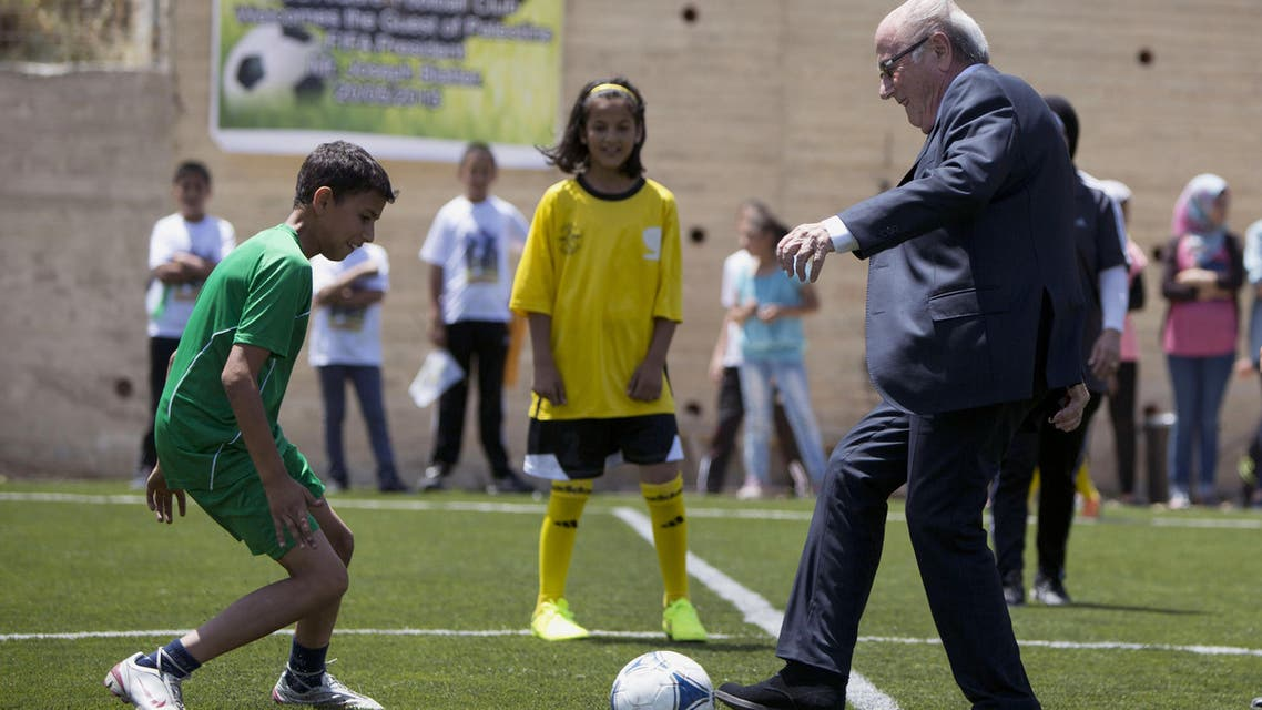 In this Wednesday, May 20, 2015 file photo, FIFA President Sepp Blatter kicks a ball during the inauguration of a football stadium in the village Dura Al-Qari' near the West Bank city of Ramallah. An aborted bid by the Palestinians to expel Israel from FIFA, the world soccer federation, has set off an uproar in Israel, raising fears that more such diplomatic assaults are on the way. (AP Photo/Majdi Mohammed, File)