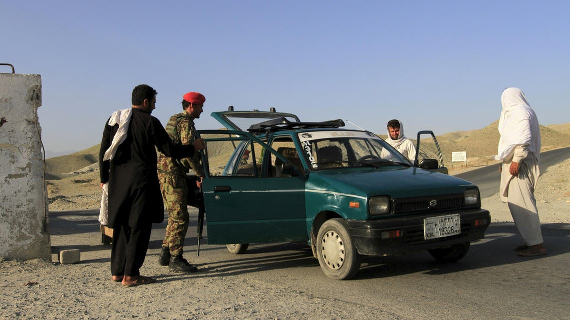 Afghan National Army (ANA) soldiers check a vehicle at a checkpoint on the outskirts of Jalalabad, June 29, 2015.