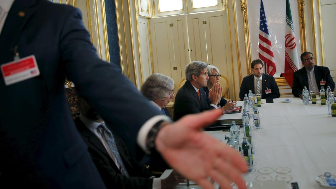 A security personnel asks reporters to leave a room where U.S. Secretary of State John Kerry (C) is meeting with Iranian Foreign Minister Mohammad Javad Zarif (not pictured) at a hotel in Vienna, Austria June 28, 2015. (Reuters)