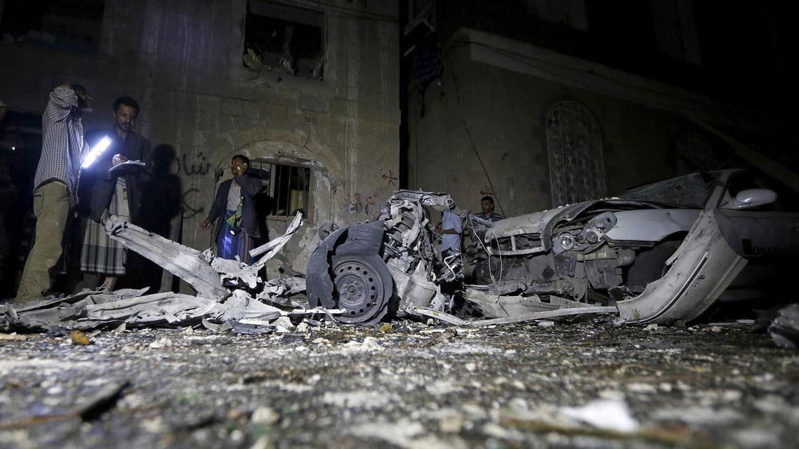 Police officers inspect the site of a car bomb attack in Yemen's capital Sanaa. (Reuters)