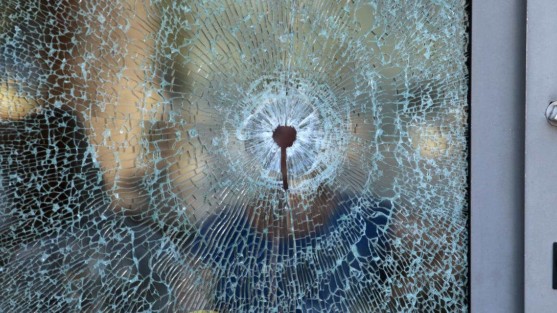 A broken glass window of the Imperiale Marhaba hotel is seen after a gunman opened fire at the beachside hotel in Sousse, Tunisia June 26, 2015.