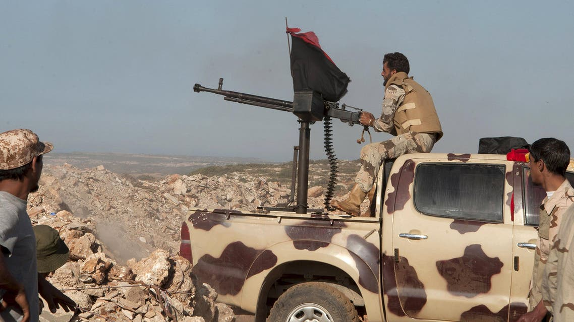 Members of the Libyan pro-government forces, aim a weapon during their deployment in the Lamluda area, southwest of the city of Derna , Libya June 16, 2015. Reuters