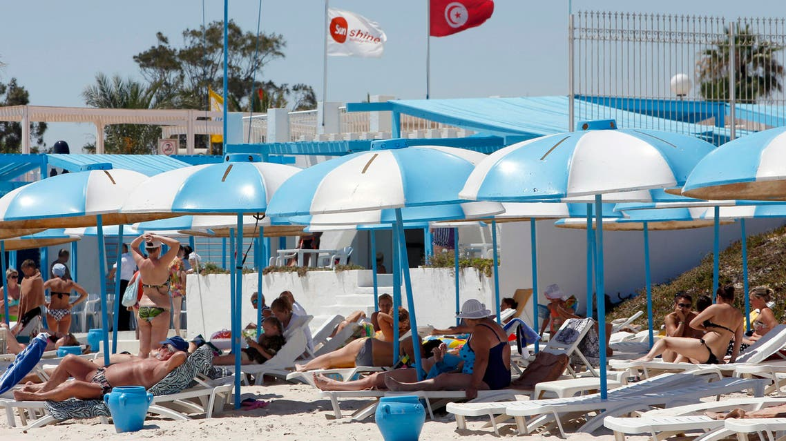 Tourists sunbathe at the Mediterranean resort of Sousse, Tunisa, four days after Friday's terrorist attack, Tuesday, June 30, 2015. One of Tunisia's top security officials says the gunman who killed 38 tourists, mostly Britons, in a beach attack was trained in neighboring Libya at the same time as the attackers who targeted the Bardo museum in March. (AP Photo/Abdeljalil Bounhar)