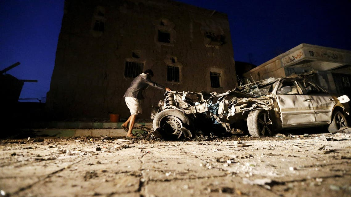 A man checks the wreckage of a car at the site of a car bomb attack in Yemen's catpital Sanaa June 17, 2015. (Reuters)
