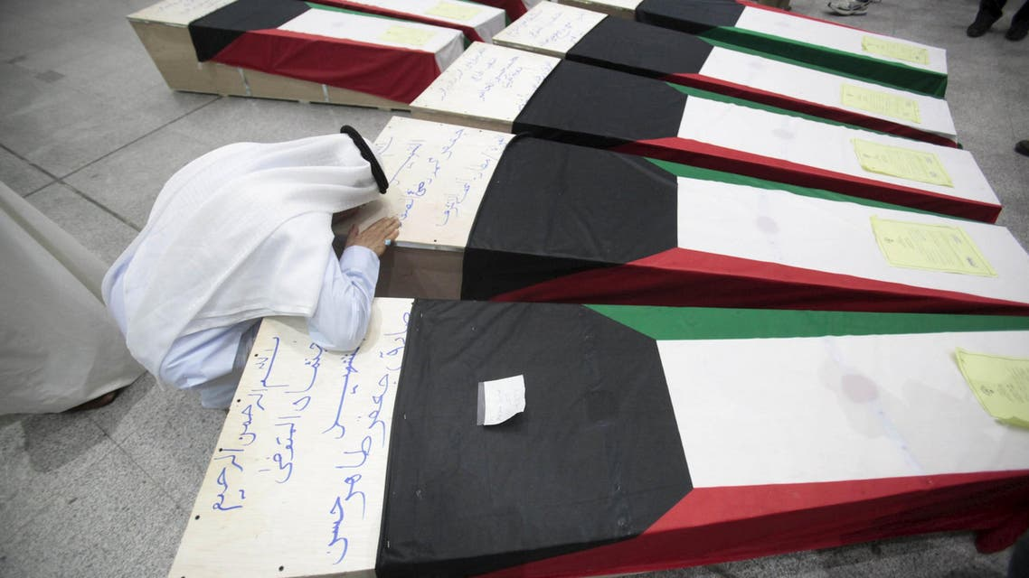 A man reacts next to coffins of victims of Friday's bombing at the Imam Sadeq mosque in Kuwait City, at the international airport in Najaf, south of Baghdad, June 27, 2015. The attack, which killed 27 and injured more than 200 at the mosque, was claimed by Islamic State's Wilayat of Najd division. Some of victims' bodies have been brought to the Shi'ite holy cities of Najaf and Karbala in Iraq for burial. The coffins are seen shrouded with Kuwaiti flags. REUTERS/Alaa Al-Marjani TPX IMAGES OF THE DAY Open in New Window Download Picture Share via EmailPrint      Date28/06/2015 00:09     Dimensions3000 x 2000     Size589KB
