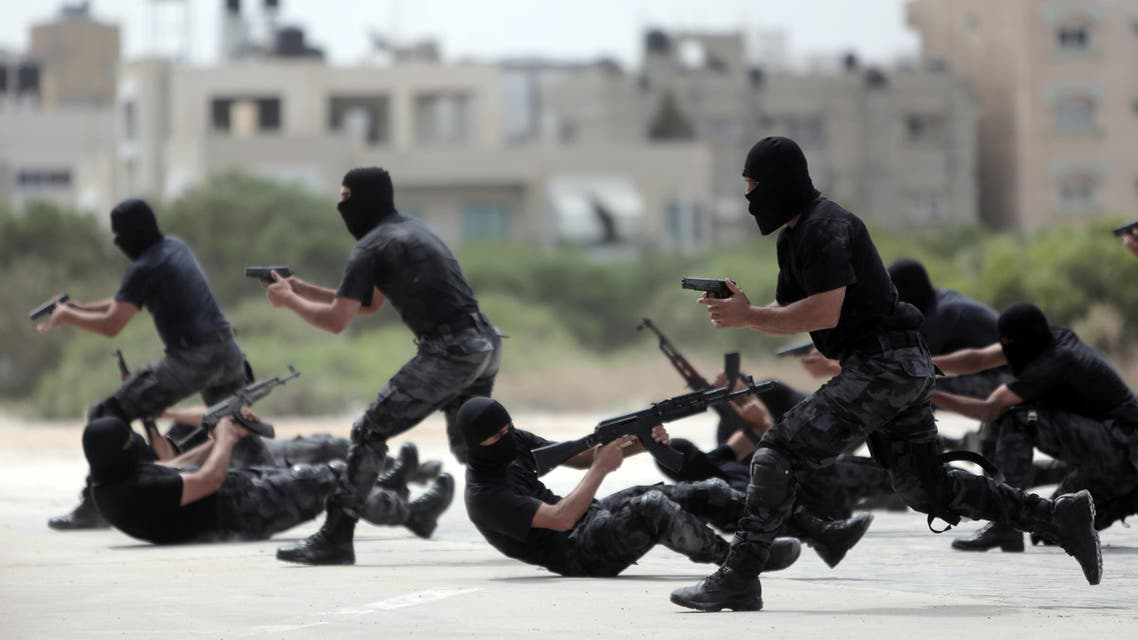 Palestinian Hamas security forces display their military skills during a police academy graduation ceremony in Gaza City, Thursday, May 21, 2015. (AP)