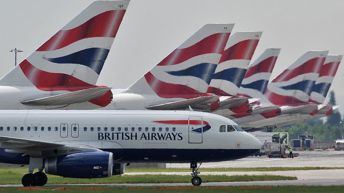 A file picture taken on May 21, 2010, shows British Airways aircraft at London's Heathrow Airport. Britain should build a third runway at London Heathrow airport to ease congestion, a government-appointed commission recommended on Wednesday July 1, 2015, despite opposition from environmentalists and London mayor Boris Johnson. AFP PHOTO / CARL DE SOUZA/FILES