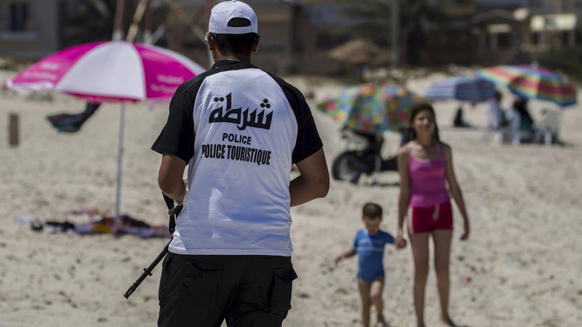 A tourist police officer patrols at the beach near the Imperiale Marhaba hotel, which was attacked by a gunman in Sousse, Tunisia, July 1, 2015. (Reuters)