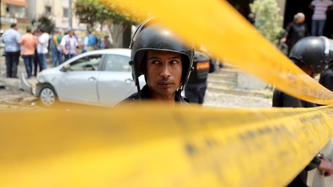Policemen investigate the site of a car bomb attack on the convoy of Egyptian public prosecutor Hisham Barakat near his house at Heliopolis district in Cairo, Egypt, June 29, 2015. REUTERS