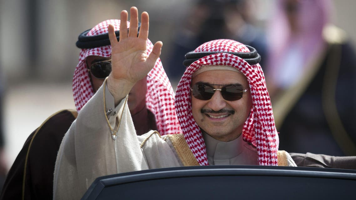 Saudi billionaire Prince Alwaleed bin Talal, waves as he arrives at the headquarters of Palestinian President Mahmoud Abbas in the West Bank city of Ramallah, Tuesday, Feb. 4, 2014. (AP)