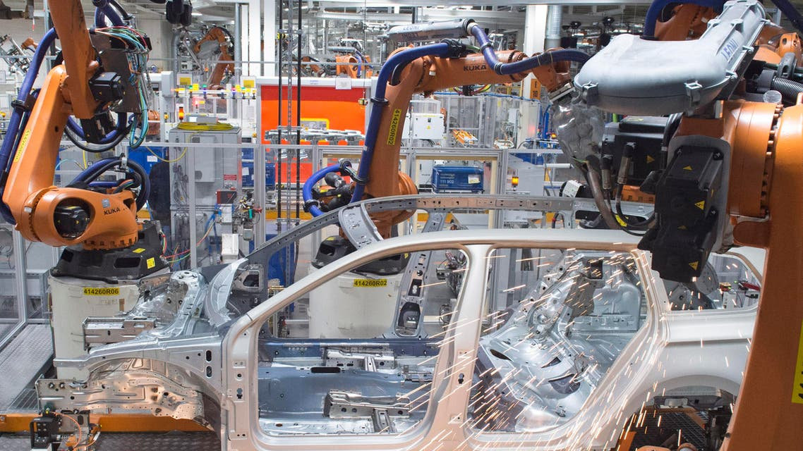 Robots weld a Passat Variant body during a press tour at the plant of the German car manufacturer Volkswagen Sachsen in Zwickau, Germany, Monday, Jan. 26, 2015. More than 4.7 Million vehicles (Golf and Passat) have left the production facilities since foundation of the Zwickau plant in 1990. (AP Photo/Jens Meyer)