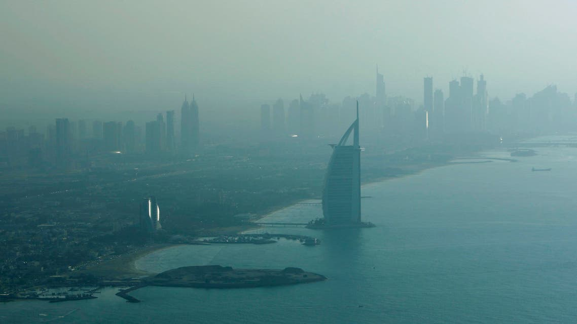 With Burj Al Arab, the luxury hotel in front, the Marina high rises are seen in the background from the plane in Dubai, United Arab Emirates. (AP)
