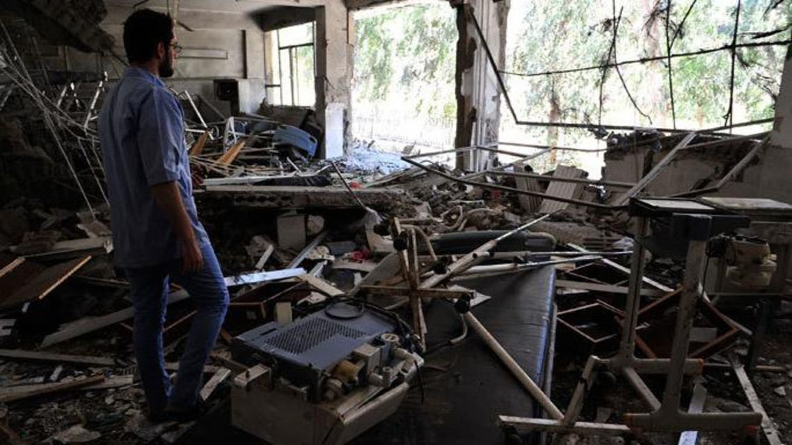 A medic inspects the damage at Raqqa national hospital, hit by what activists said was a Syrian Air Force fighter jet loyal to President Bashar al-Assad in Raqqa province, eastern Syria June 20, 2013.(Reuters / Nour Fourat)