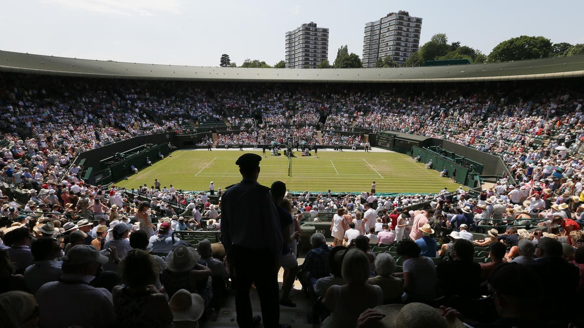 Spectators on No. 1 Court watch the match between Milos Raonic of Canada and Tommy Haas of Germany at the All England Lawn Tennis Championships in Wimbledon, London, Wednesday July 1, 2015. (AP)